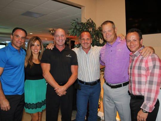 Carmine and Laurie Izzo, from left, Ed Hochard, Tony