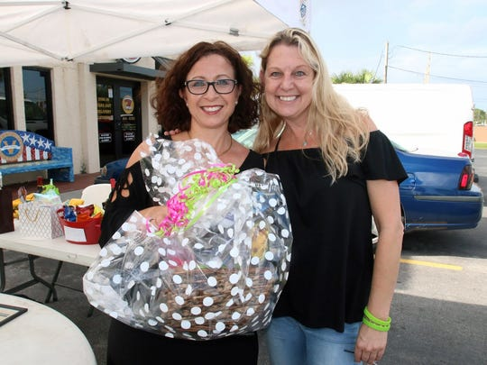 Shelly Anton, left, drops off a donation with Candice