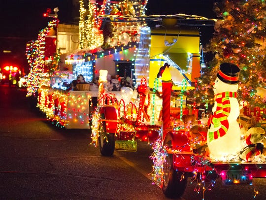 Illuminated floats, antique cars, firetrucks and more