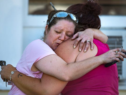 Carrie Matula embraces a woman after a fatal shooting