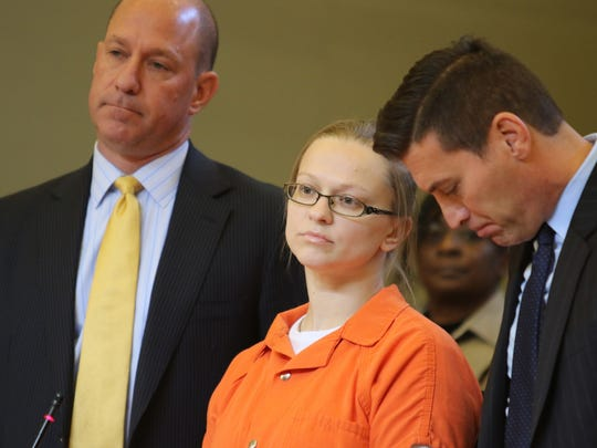 Angelika Graswald stands with her lawyers, Jeffrey Chartier, left, and Richard Portale, during her sentencing in Orange County Court.