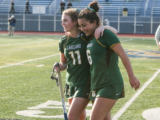 Lakeland's Julia Papanicolaou Julianna Cappello (11) and Emily Kness (6) celebrated the win over Burnt Hills-Ballston  3-0 in Class B State Semifinals in Maine-Endwell. Nick Serrata - For The Journal News
