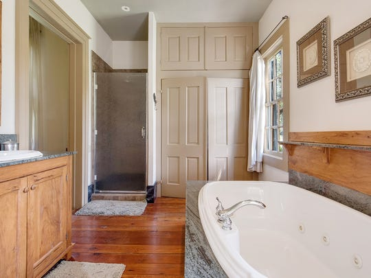 Some updated amenities include a master bath with spa tub.