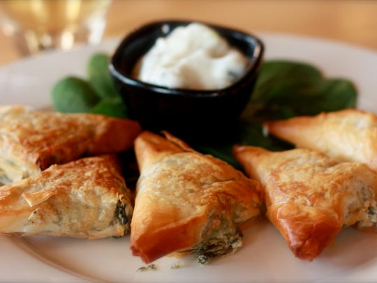 Individual spanakopita, an appetizer at Cafe Manna,
