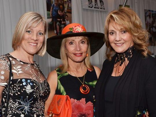 Elizabeth Fedele, left, Dr. Linda Kardos and Dana Coates show their support for the Humane Society of the Treasure Coast.