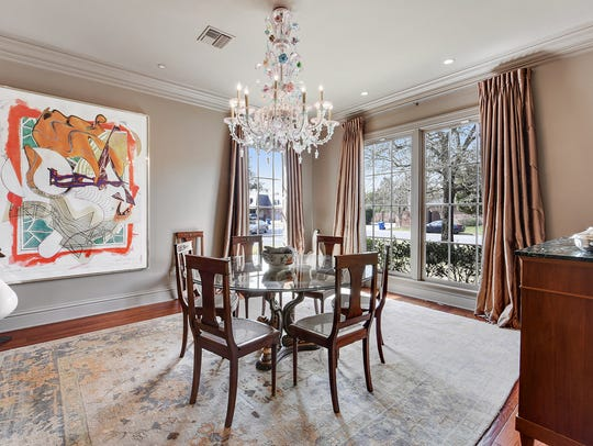 The formal dining room is full of natural light.