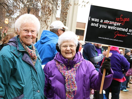 Blessed Virgin Mary Sisters, Sara McAlpin, left, and Catherine Jean Hayen attend a rally in Dubuque, Iowa, in support of immigrants and refugees.