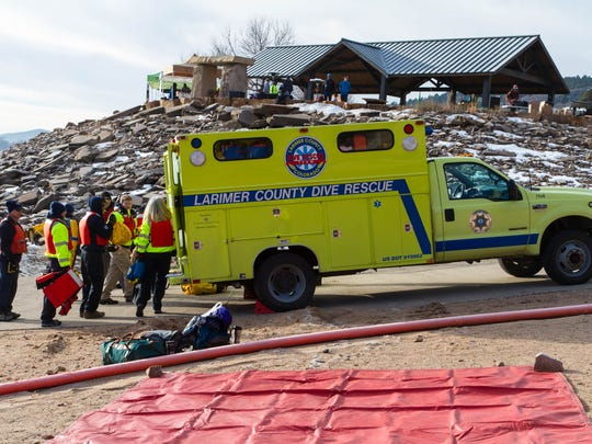 Larimer County Dive Rescue Team members with the dive truck the team is hoping to replace on Jan. 21, 2017, at the Polar Plunge in Fort Collins.
