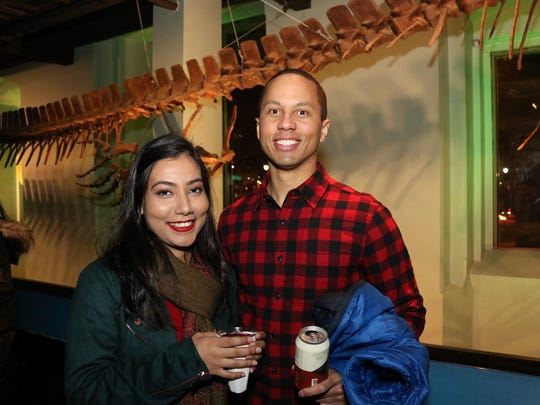 Guests enjoy drinks at Dinos After Dark at the Academy of the Natural Sciences at Drexel University.