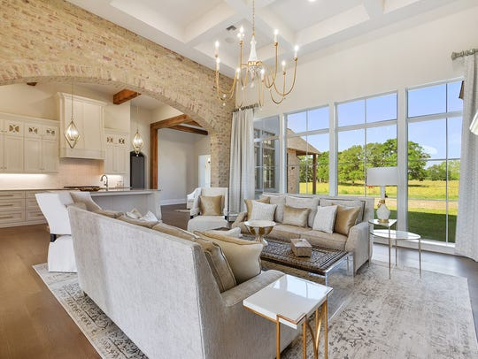 The kitchen and living areas also include outdoor views.