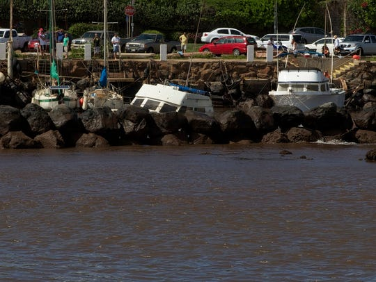 Boats stuck in the silt after water levels dropped