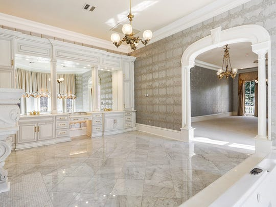 The master suite features an incredible marble bath and dressing area.
