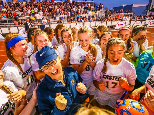 Sandy Lundberg celebrates with the Casteel girls soccer
