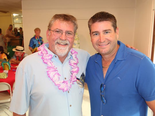 """Event Sponsors A&G Concrete Pools Inc. owners Art Allen and Travis Leonard  at the """"Flip Flops and Leis"""" fundraiser for the Lil Feet program that provides footwear for children in need in St. Lucie County."""