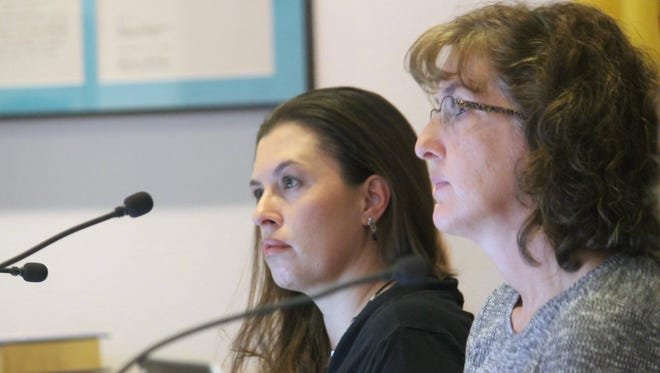 Commissioners Erica Martin and Jenny Turnbull listen intently as Mark Threadgill, the city's customer service manager, gives the commission an overview of their utility system.