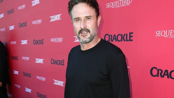 Not your average mid-life crisis: David Arquette is back in the wrestling ring despite being 47 and having had a heart attack in the last two years.