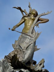 A bronze statue of a mermaid playing a cello stands at the entrance of the Ventura Harbor. The statue is one of two that Camarillo resident Alec Benke has donated. The other sits directly across the harbor and is of a mermaid playing a flute.