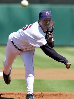 Boston Red Sox starting pitcher Pedro Martinez delivers a warm-up pitch at the start of the game against the Toronto Blue Jays Tuesday, March 14, 2000, in Fort Myers, Fla. Martinez pitched three innings with no hits, no runs, no walks and six strikeouts. (AP Photo/Pat Sullivan)