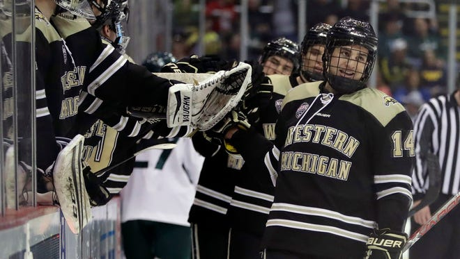 Western Michigan forward Jade McMullen (14) is congratulated after scoring during the first period of a Great Lakes Invitational college hockey game against Michigan State, Thursday, Dec. 29, 2016, in Detroit.