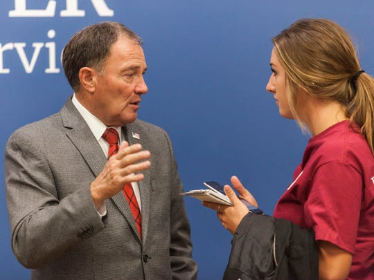 A Southern Utah University student talks with Governor