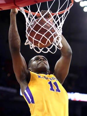 Milwaukee Washington's  Michael Foster throws down a dunk during last season's state tournament.