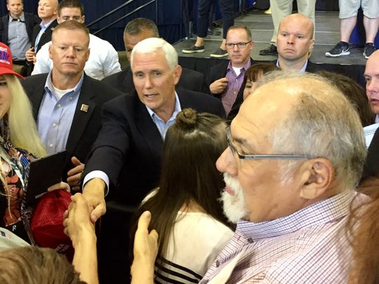 Vice President Mike Pence shakes hands with audience members at MetraPark in Billings in May.