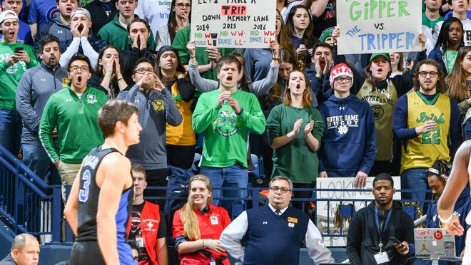Jan 30, 2017; South Bend, IN, USA; The Notre Dame student section holds signs referencing Duke Blue Devils guard Grayson Allen (3) in the first half of the game against the Notre Dame Fighting Irish at the Purcell Pavilion. Mandatory Credit: Matt Cashore-USA TODAY Sports ORG XMIT: USATSI-334688 ORIG FILE ID:  20170130_kkt_sc5_226.JPG