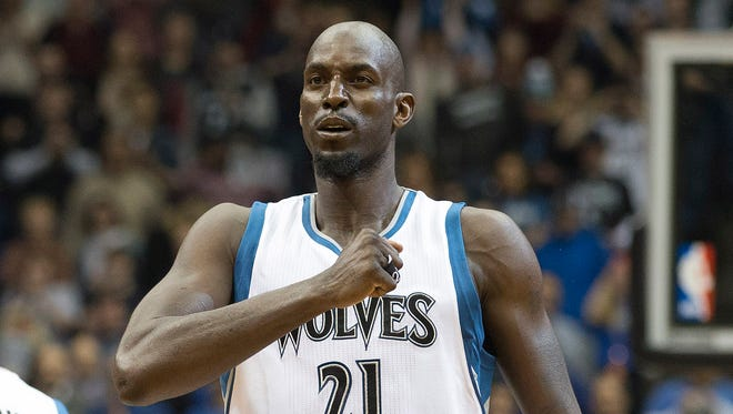 Minnesota Timberwolves forward Kevin Garnett pounds his chest before his first game back in Minnesota.