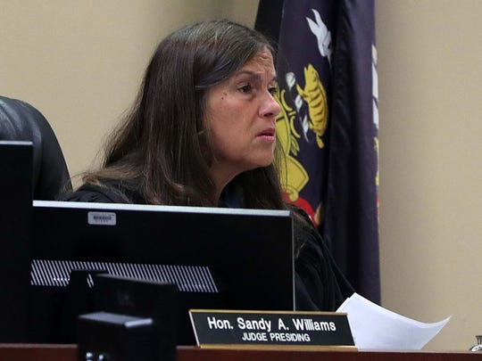 Ozaukee County  Circuit Judge Sandy Williams listens as Amber Schmunk, 29, of Grafton, pleads not guilty to second-degree recklessly endangering safety. She is accused of driving with her 9-year-old son on the roof of her minivan.