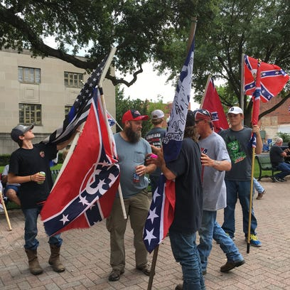 Members of the Gulf Coast Patriot Network waved Confederate