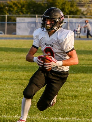 Pinckney's Alex Wasyl looks for extra yardage after making a catch in a 30-21 victory at Ypsilanti Lincoln.