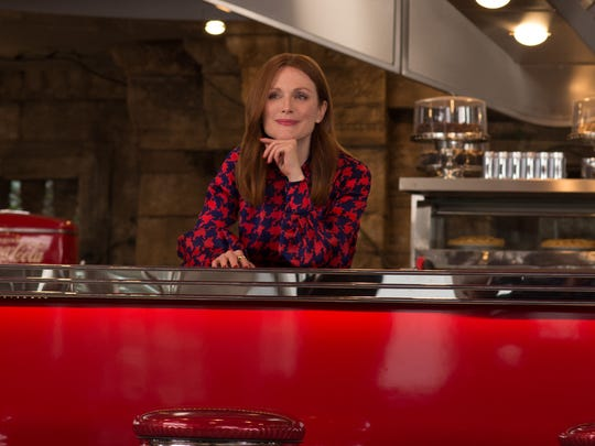 """Poppy (Julianne Moore) is a drug dealer with nefarious plans in """"Kingsman: The Golden Circle."""""""