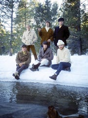 The Beach Boys, circa 1960s.  Seated from left: Bruce Johnston, Brian Wilson, Mike Love. Standing from left: Al Jardine, Dennis Wilson,