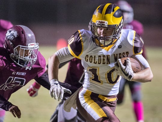 Golden West's Benjamin Davis runs away from Mt. Whitney's