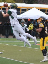 Groves senior Ryan Flaherty (2) nearly came up with