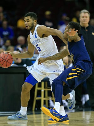 Kentucky's Andrew Harrison drives past WVU's Daxter Miles, Jr. during Thursday evening's Sweet 16 game in Cleveland. Andrew Harrison had 13 points. The Wildcats rolled past the Mountaineers 78-39. March 26, 2015.
