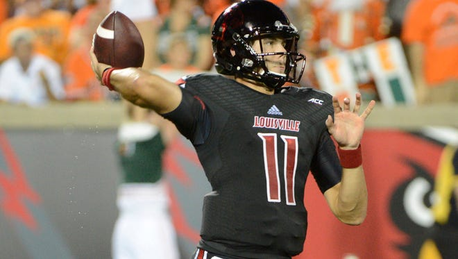 Louisville Cardinals quarterback Will Gardner prepares to throw a pass against the Miami Hurricanes during the first quarter of play at Papa John's Cardinal Stadium.