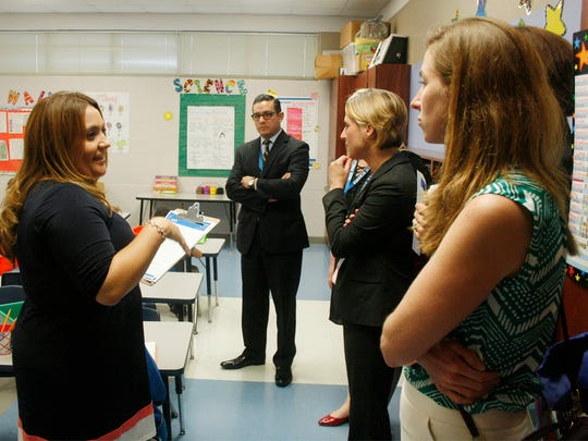 State Rep. César Blanco, center, and Amy O'Rourke, far right, talk with IDEA Pharr Academy Principal Sonia Aguilar during a visit to the charter school near McAllen.