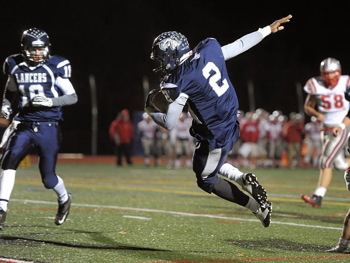 Jametrius Lewis dives into the end zone for an Eastridge TD.