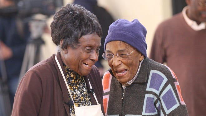 Rosa Wims, left, shares a laugh with her cousin Doris Screen in the 2014 file photo. Wims was in her 29th and what was said to be her last year helping to feed the hungry in Rochester with an annual pre-Thanksgiving meal.