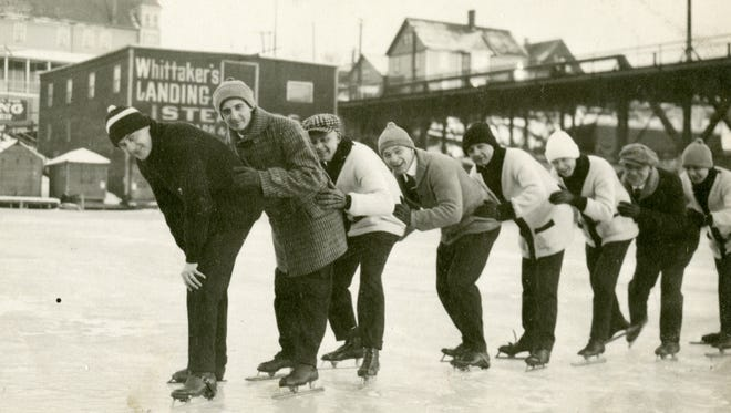 Skaters line up for a spin on the Milwaukee River. Skating on the frozen river was once a popular winter activity in the city.