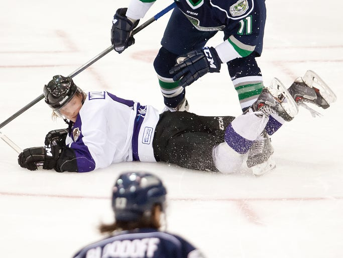 Florida Everblades' Maxime Langelier-Parent, top, takes out a Reading player during first period play at Germain Arena in Estero on April 9, 2014.