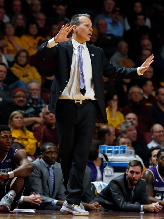 Northwestern coach Chris Collins watches the second half of the team's NCAA college basketball game against Minnesota on Tuesday, Jan. 23, 2018, in Minneapolis. Northwestern won 77-69. (AP Photo/Jim Mone)