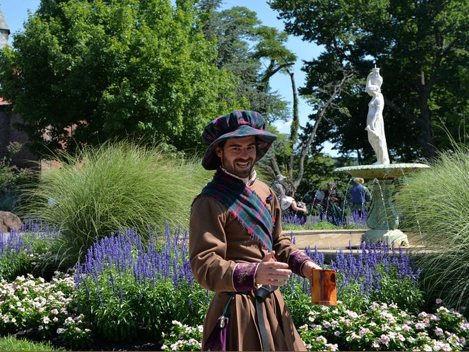 A re-enactor welcomes visitors to the opening of the