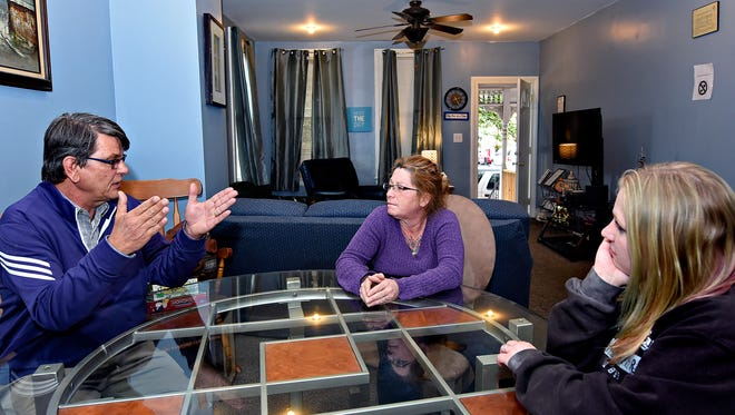 """Home owner Dave Dunkel, left, talks with residents Jennifer Young, center, of York City, and Trishya Bouse, of Towanda, in their recovery home on Pennsylvania Avenue in York, Tuesday, May 3, 2016. Dunkel offers to bring Bouse a """"Heroin Cravings Index"""" of helpful information he has compiled in hopes of building an APP at some point in the future. Dawn J. Sagert  photo"""