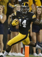 Iowa's Desmond King said he is 50-50 whether or not he will go to the NFL or stay with the Hawkeyes for his senior season.