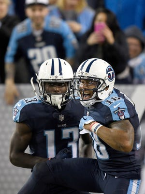 Titans wide receiver Taywan Taylor (13) celebrates his touchdown with wide receiver Rishard Matthews (18) in the second half Monday night at Nissan Stadium.
