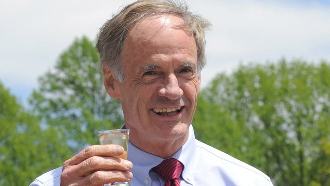 Senator Tom Carper samples Delaware's first hard peach cider, a joint effort by TS Smith Farms and Great Shoals Winery, in May of 2013.