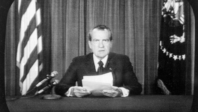 President Richard Nixon sits in the White House Oval Office as he announces his resignation on nationwide television on Aug. 8, 1974. Nixon faced impeachment hearings in the U.S. House over the Watergate break-in of Democratic National Committee offices and its subsequent cover-up, and he resigned before impeachment could be sent to the U.S. Senate.