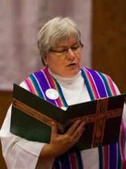 Pastor Sue Ringler, seen in 2013, and some women in